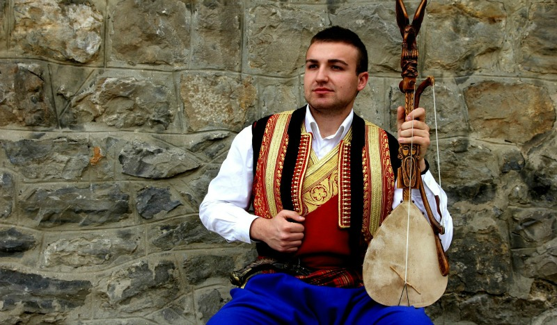 Montenegrin guslar in national costume.